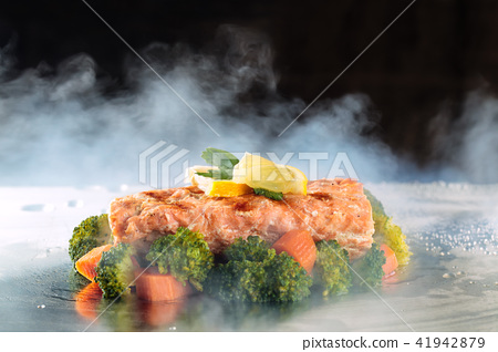 Salmon and steamed vegetables. 41942879
