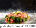 Salmon and steamed vegetables. 41942880