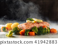 Salmon and steamed vegetables. 41942883
