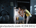 Black Woman Looking into Fridge For Midnight Snack 41943032