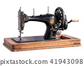 Ancient sewing machine. 41943098
