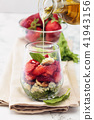 Spinach salad in glass. 41943156