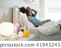 Black Woman With Flu And Cold Holding Ice Bag 41943243