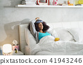 Black Woman With Flu And Cold Holding Ice Bag 41943246