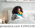 Black Woman With Flu And Cold Holding Ice Bag 41943248