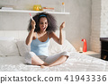 Happy Woman Smiling For Joy With Pregnancy Test Kit 41943336
