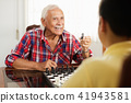 Grandpa Playing Chess Board Game With Grandson At Home 41943581