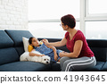 Mother Checking Temperature To Ill Daughter With Thermometer 41943645