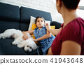 Mother Checking Temperature To Ill Daughter With Thermometer 41943648