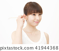 Female Earpicking 41944368