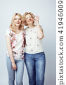 mother with daughter together posing happy smiling isolated on w 41946009