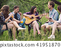 Group of friends sitting in circle out in park. 41951870