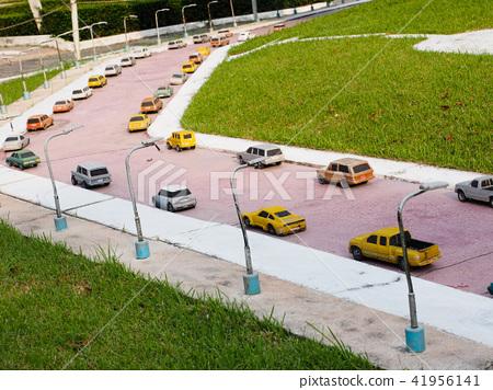 Toy model figure cars in traffic circle scene 41956141