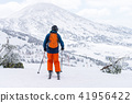 Skiers and snowboarder prepare to start 41956422