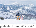 Skiers and snowboarder prepare to start  41956428