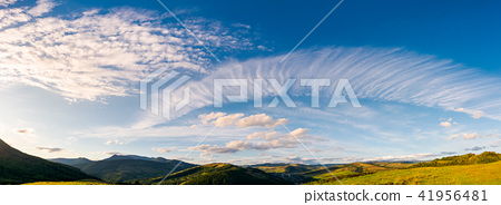 gorgeous evening clouds over the mountains 41956481