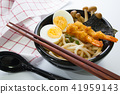 japanese white udon noodle in black bowl 41959143