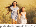 young girl in the yellow field 41960217