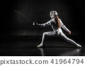 Female fencer isolated on black background 41964794