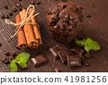 sweets, cinnamon sticks and chocolate muffin 41981256