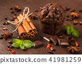 sweets, cinnamon sticks and chocolate muffin 41981259