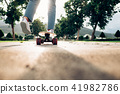 Young teen girl on longboard in the city. 41982786