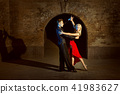 Beautiful young couple dancing tango. 41983627