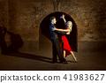 Beautiful young couple dancing tango. 41983627