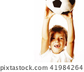 little cute boy playing football ball isolated on white close up 41984264