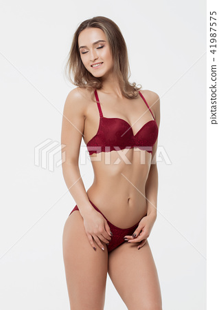 792088a364c Hot woman in red lingerie touching breast - Stock Photo  41987575 ...