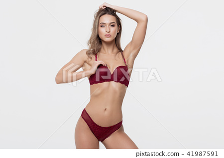 d02499846a1 Hot woman in red lingerie touching breast - Stock Photo  41987591 ...