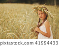 young girl in the yellow field 41994433