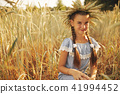 young girl in the yellow field 41994452