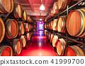 Old cellar with big wooden wine barrels 41999700