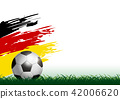 Soccer ball on grass with paintbrush 42006620