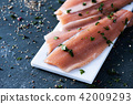 slices of raw trout 42009293