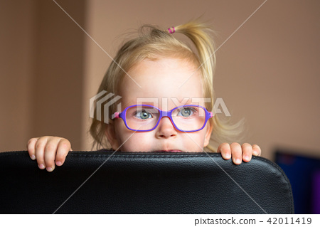 Little girl in glasses portrait 42011419