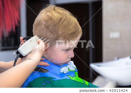 Haircut of three years old boy 42011424