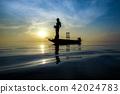 Silhouettes fisherman throwing fishing nets 42024783