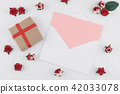 Brown gift box and pink card in white envelop 42033078
