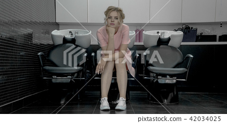 Young pretty girl sit in armchair with washbasin in professional salon 42034025