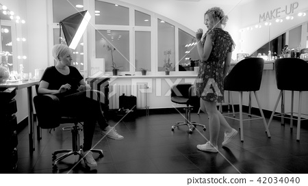 Two young girls in makeup room, black and white photo 42034040