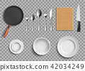 Set of ceramic plates and kitchen utensils. 42034249