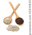 Wooden spoon and peppercorn on white background 42034635