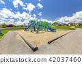 Blue skies above playground 42037460