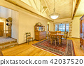 Bright, open and warm dining room with vaulted  42037520
