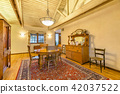 Bright, open and warm dining room with vaulted  42037522