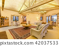 Bright, open and warm living room with vaulted 42037533