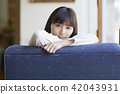 A woman relaxing at a cafe 42043931