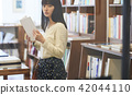 A woman in a book store 42044110
